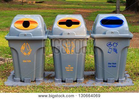 Recycle bins at public park. Public garbage bins.