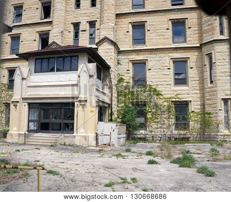 JOLIET, ILLINOIS / UNITED STATES - MAY 3, 2015: The front entrance of the old Illinois State Penitentiary, now vacant and abandoned.