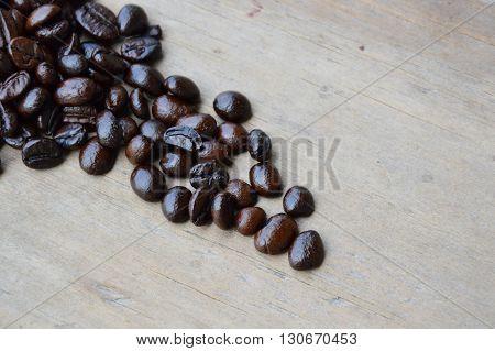 coffee seed arrange on the wooden board