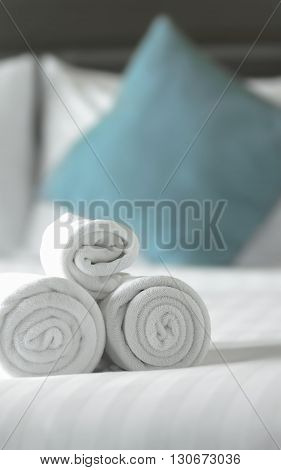 close up white towels on the bed