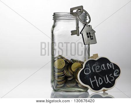 house shaped key chain and saving jar