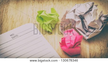 Writers Block. Paper Lump. On Wooden Background. Add Noise And Grains Vintage Tone