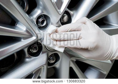 Car detailing series : Closeup of hand coating car wheel