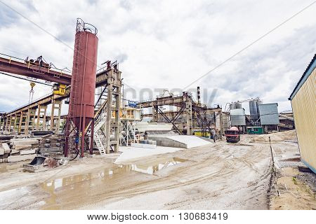 KIEV, UKRAINE - MAY 20, 2016: Old factory for concrete production. The staff and machines of the old workshop of concrete production. Technological processes of concrete production