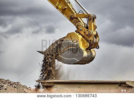 Construction Industry Excavator Bucket Loading Gravel Closeup