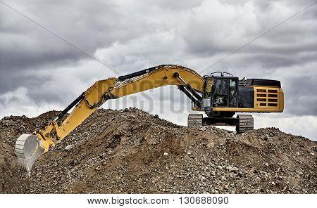 Constuction Industry Excavator Heavy Equipment Full Reach On Job Site