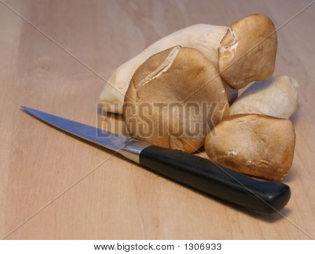 French Horn Mushrooms With Knife