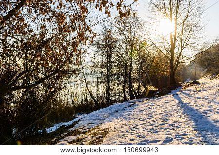 Beautiful winter sunrise on the river. Fabulous winter landscape.