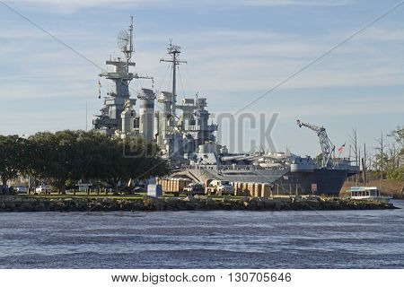 Wilmington North Carolina USA - November 13 2015: View of the USS North Carolina Battleship docked on the Cape Fear River in North Carolina on a sunny day on November 13 2015 in Wilmington North Carolina