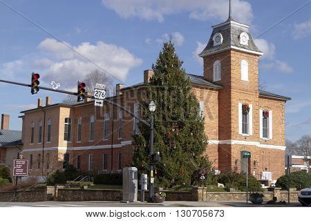 Brevard North Carolina USA - December 11 2015: Festive downtown street intersection in the small town of Brevard North Carolina with a white squirrel emblem on the traffic light pole showing that it's know for its albino squirrels December 11 2015 in down