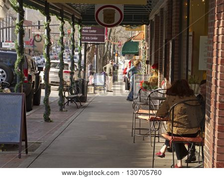 Brevard North Carolina USA - December 11 2015: Downtown street scene in the small town of Brevard North Carolina in December with Christmas decorations up and people shopping for the holidays on December 11 2015 in downtown Brevard NC