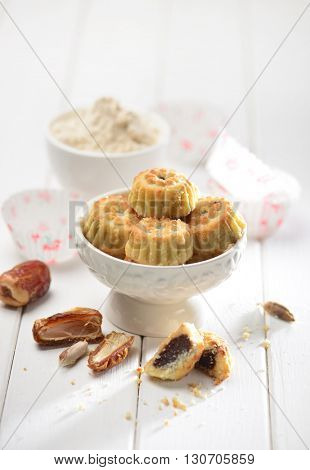 Date maa'moul arranged with date fruit and raw ingredients. Typical middle eastern cuisine.