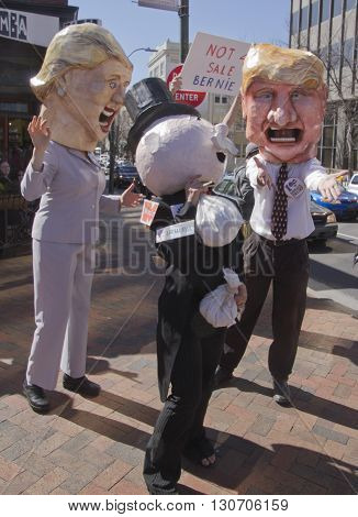 Asheville, North Carolina, USA - February 28, 2016: Parody of Hillary Clinton and Donald Trump entreating Mr. Monopoly for his money at a Bernie Sanders campaign rally on February 28, 2016 in downtown Asheville, NC