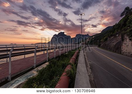 Rio de Janeiro, Brazil - April 22, 2016: The new Tim Maia bike path along Avenida Niemeyer connects Leblon with Barra da Tijuca and is a legacy project of the Games.