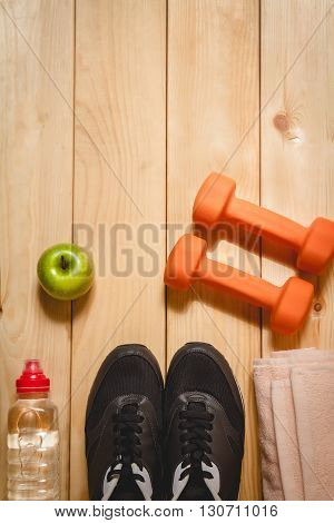 Sports equipment on the wooden floor. top view