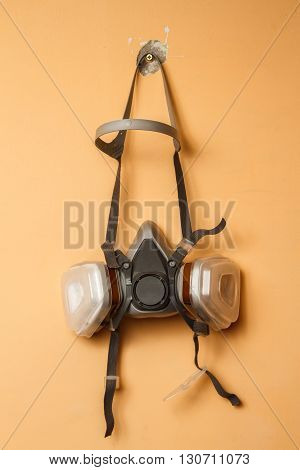 Respirator mask on the wall. Copy space