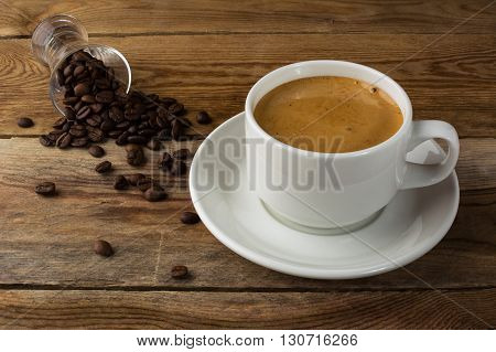 Strong coffee on the wooden background. Strong coffee. Morning coffee. Coffee break. Strong coffee. Coffee cup. Cup of coffee. Coffee mug.