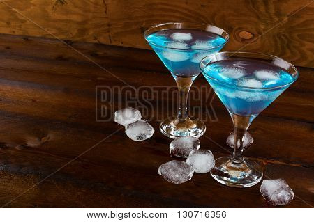 Blue cosmopolitan cocktail with ice. Blue margarita. Blue cosmopolitan. Blue Lagoon. Blue cocktail. Blue Martini. Blue Hawaiian cocktail. Blue curacao liqueur.