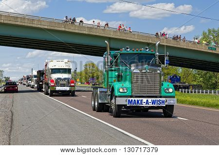 LANCASTER PA - MAY 8 2016: Make-A-Wish Foundation sets a new Guinness World Record for the largest truck convoy. On the Mother's Day annual fundraiser truckers grant a Lancaster County wish ride to children with life-threatening illnesses.