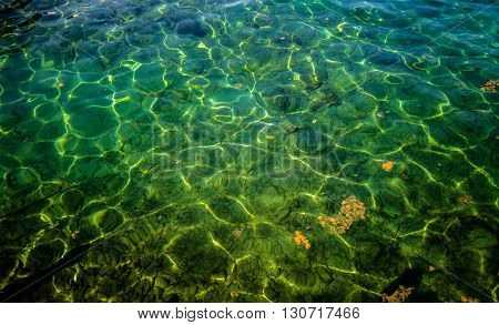 Crystal Clean Pristine Waters Of The Great Lakes. The sun reflects off the aquamarine waters of Lake Huron. Lake Huron is the second largest of the five Great Lakes.
