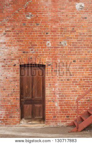 Timber Door In Red Brick Building