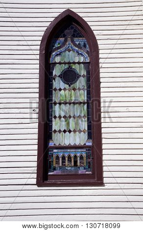A stained glass window in  the former St Mary's Catholic Church, which was originally built in 1836 as a Universalist church, and now sits abandoned in downtown Plainfield, Illinois.