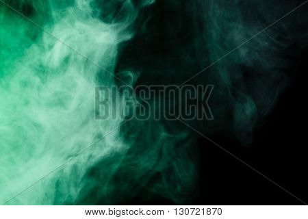 Abstract art. Virid smoke hookah on a black background. Inhalation. The steam generator. The concept of poison gas. Gas.