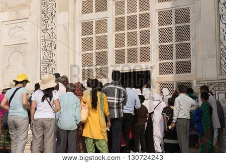 Tourists visiting the famous Taj Mahal in Agra, Delhi. Taj Mahal was built by Shah Jahan in memory of Mumtaz Mahal and depicts ethnic Mughal and Persian architecture fusion.