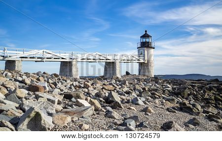 Marshall Point Light as seen from the rocky coastline in Port Clyde, Maine.