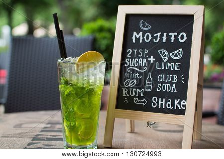 Hand drawn cocktails doodles. Mojito Chalk lettering. A variety of hand-drawn text and illustrations to compose the Mojito cocktail recipe. Mojito cocktail and recipe on the blackboard.
