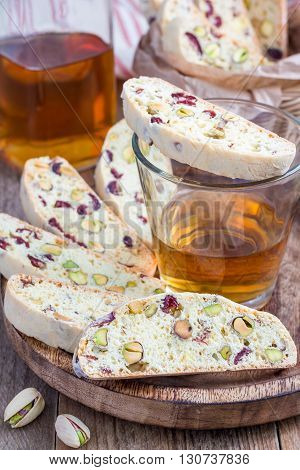 Cranberry and pistachio biscotti with vin santo wine on a table