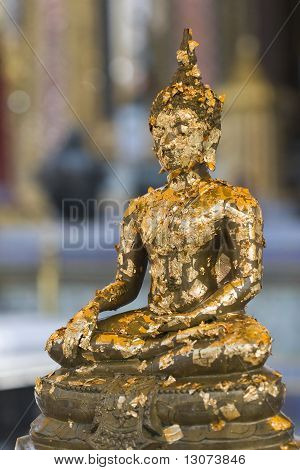 Buddha Image Covered with Gold Leaves