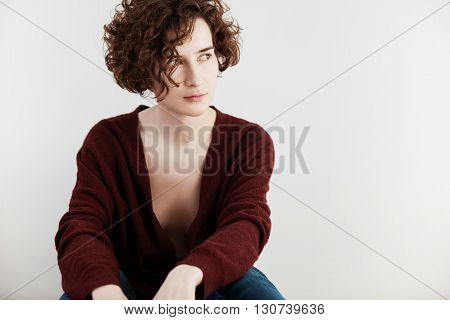 Portrait Of Caucasian Female With Short Curly Hair Cut, Wearing Casual Cardigan With Low Neckline, L