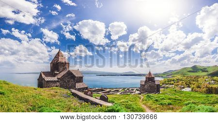 Beautiful view of old church against of magnificent blue cloudy sky and lake