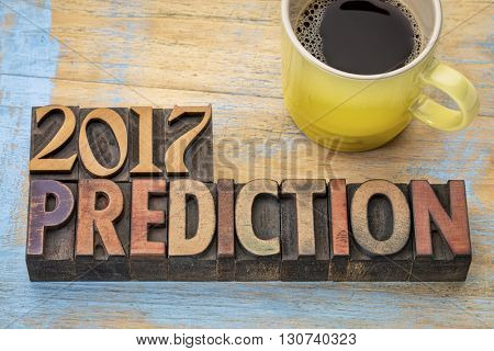 2017 prediction concept - text in vintage letterpress wood type printing blocks with a cup of coffee