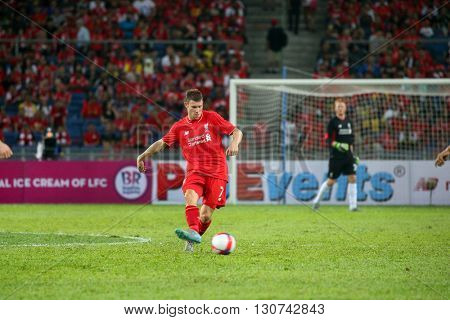 July 24, 2015- Shah Alam, Malaysia: Liverpool's James Milner passes the ball in a friendly match against the Malaysian Team. Liverpool Football Club from England is on an Asia tour.