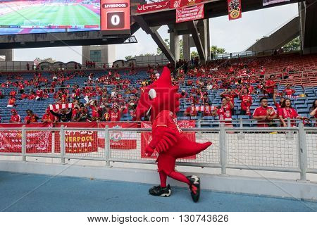 July 24, 2015 - Shah Alam, Malaysia: Liverpool FC's mascot 'Mighty Red' greets fans and supporters before the friendly game against Malaysia. Liverpool Football Club from England is on an Asia tour.