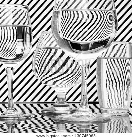 Glass with water refraction and reflection black white
