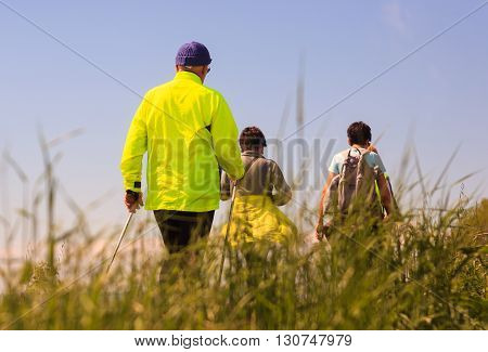GRADO ITALY - APRIL 25: Hikers walking in the countryside April 25 2016