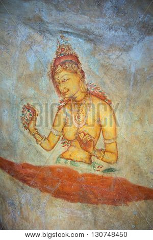 SIGIRIYA, SRI LANKA - MARCH 16, 2015: Image of royal concubines. Ancient fresco on the wall of mount Sigiriya. Historical landmark of the city Sigiriya, Sri Lanka