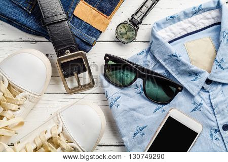 Overhead view of men's casual outfits Outfits of traveler boy male Men's casual outfits on wood board background