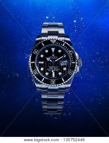Bangkok, Thailand -  March 29, 2016: Luxurious wrist watch from Rolex for men on water background. Studio shot in Bangkok, Thailand.