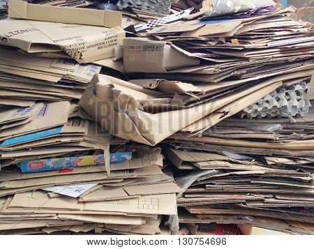 KLANG MALAYSIA - MAY 21 2016: Stack of old cardboards or packaging boxes and other packaging stuffs in junkyard recycling. Recycling has been a common practice for clean environment.