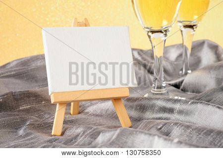 festive background with two champagne glasses and empty board