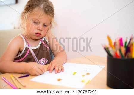 Little Girl Painting With Colored Pencil