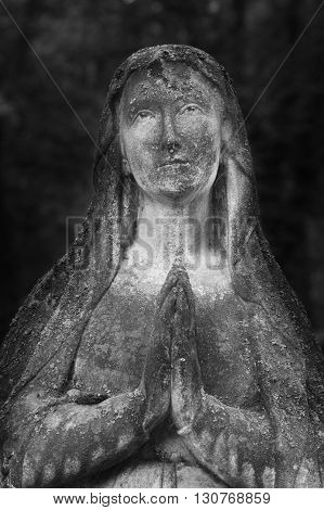 Statue of Virgin Mary as a symbol of love and kindness (antique statue religion)