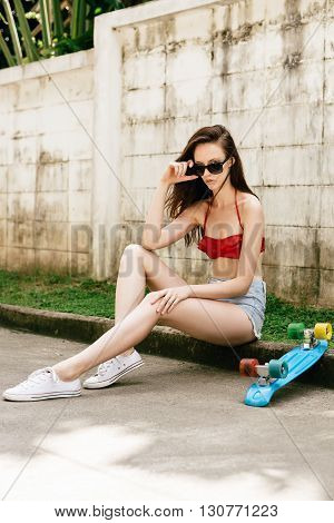 Cute Hipster Girl In Bikini With Skateboard.
