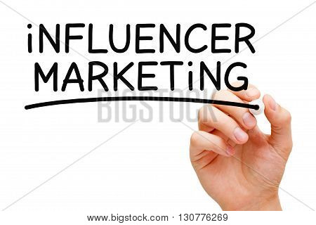 Hand writing Influencer Marketing with black marker on transparent wipe board.