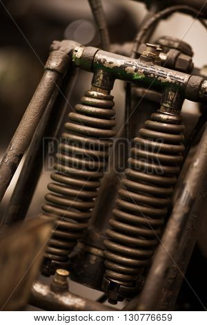 Color shot of a vintage motorcycle front shock absorber.