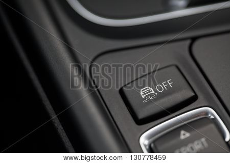 Close up shot of the ESP button in a car.